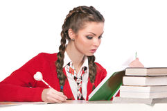Girl sitting in front of books Stock Photo