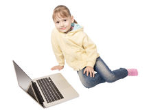 Girl sitting in front of laptop Stock Photos