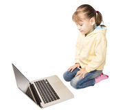 Girl sitting in front of laptop Royalty Free Stock Photography