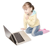 Girl sitting in front of laptop Royalty Free Stock Images