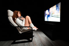 Girl sitting in front of large display Royalty Free Stock Image