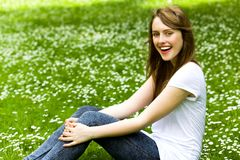 Girl sitting on the grass Stock Photo