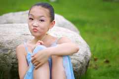 Girl sitting on the grass Royalty Free Stock Image