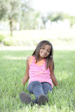 Girl sitting on the grass Stock Image