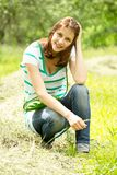 Girl sitting on the grass. Beautiful girl sitting on the grass in the park Stock Image