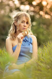 Girl sitting in the grass royalty free stock photos