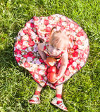 Girl sitting on the grass with apples Royalty Free Stock Photography