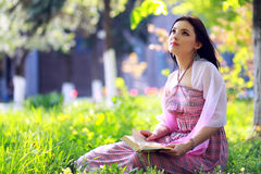 Girl sitting on a grass Royalty Free Stock Images