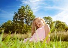 Girl sitting on grass Royalty Free Stock Photos