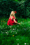 Girl sitting in grass Stock Photography
