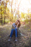 Girl sitting on the grass. Royalty Free Stock Photography