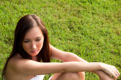 Girl sitting in Green Grass Royalty Free Stock Photography