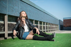 Girl sitting on green lawn Royalty Free Stock Images
