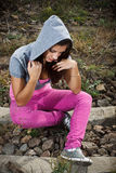 Girl sitting on the ground Stock Image