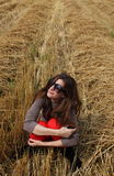 A girl sitting in a haystack stock images