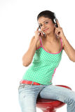 Girl sitting with headphones Royalty Free Stock Photography