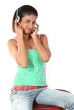 Girl sitting with headphones Royalty Free Stock Photos
