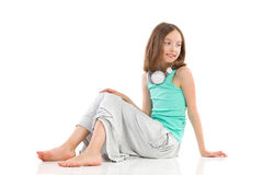Girl sitting with headphones on her neck Royalty Free Stock Photography