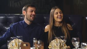 Girl sitting with her boyfriend actively tells an interesting story to your friends. Expressive girl tells the story to his friends,she actively tells the story stock footage
