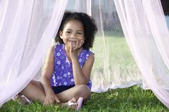 Girl sitting in her canopy Stock Photography