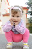 Girl SItting on Her Haunches Royalty Free Stock Photography