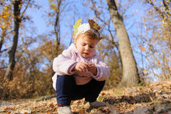 Girl Sitting on Her Haunches Royalty Free Stock Photo