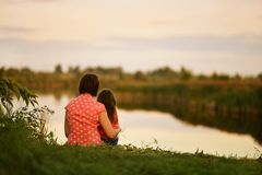 Girl sitting with her mother Royalty Free Stock Photo