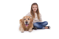 Girl sitting beside her pet dog Royalty Free Stock Image