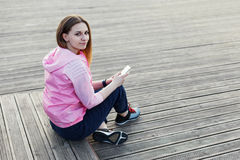 Girl sitting with her phone Royalty Free Stock Images