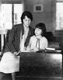 Girl sitting with her teacher in a class room Royalty Free Stock Images