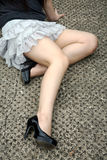 Girl sitting high heels. Girl sitting with high heels and miniskirt Royalty Free Stock Photo