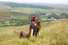 Girl sitting on the hill Royalty Free Stock Image
