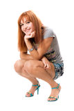 Girl sitting on his haunches Royalty Free Stock Image