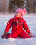 Girl sitting on his lap in the snow Stock Photos