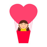 Girl sitting in hot air balloon in the shape of heart Royalty Free Stock Images