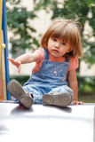 Girl sitting at hutches with disheveled hair Royalty Free Stock Photography