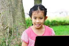 Girl Sitting In Park With A Laptop Stock Image