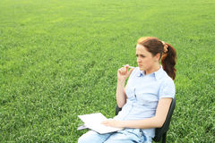 Girl Sitting In The Field Stock Photo