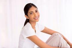 Girl sitting indoors. Beautiful indian girl sitting indoors Stock Photos