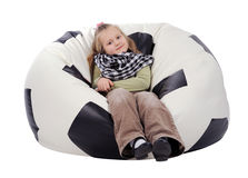 Girl sitting on an inflatable chair Stock Images