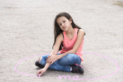 Girl sitting in an intimate circle Stock Photo