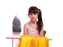 Girl sitting with ironing board and iron Royalty Free Stock Photos