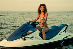 Girl sitting on a jet ski Royalty Free Stock Images