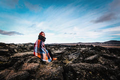 Girl sitting in Krafla volcanic area, Iceland Royalty Free Stock Photo