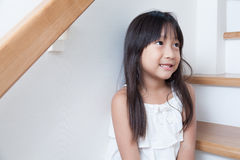 Girl sitting in on the ladder Royalty Free Stock Photos