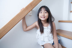 Girl sitting in on the ladder Stock Images