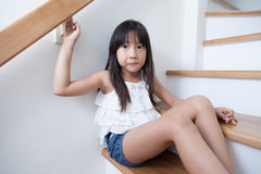 Girl sitting in on the ladder Royalty Free Stock Photo