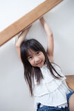 Girl sitting in on the ladder Stock Photos
