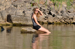Girl sitting in lake Royalty Free Stock Photo