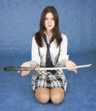 Girl sitting in a lap stretches us a sword Royalty Free Stock Photos